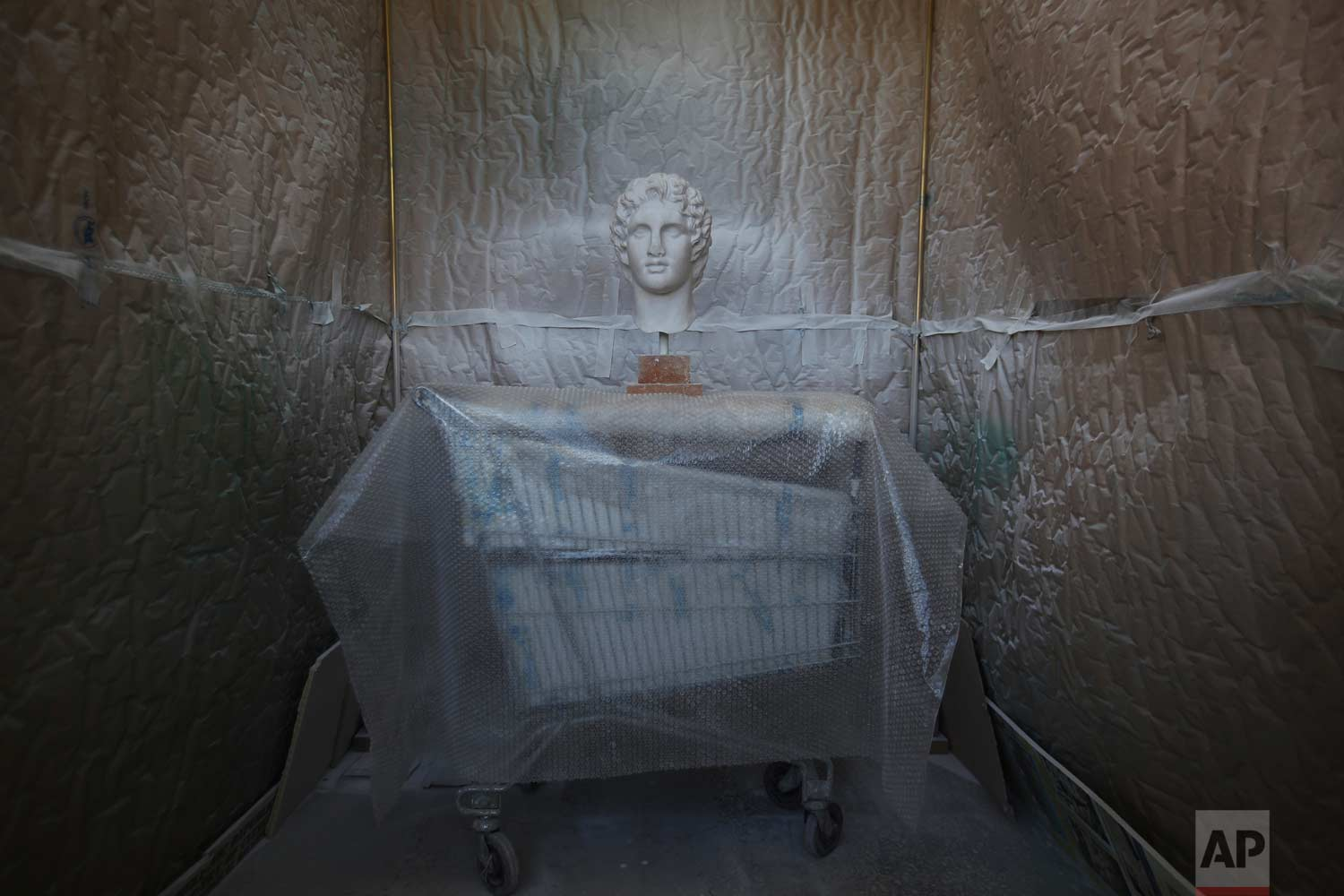 In this Monday, Jan. 22, 2018, a copy of the head of Alexander the Great goes through color processing in Culture Ministry's Lab in Athens.  (AP Photo/Thanassis Stavrakis)