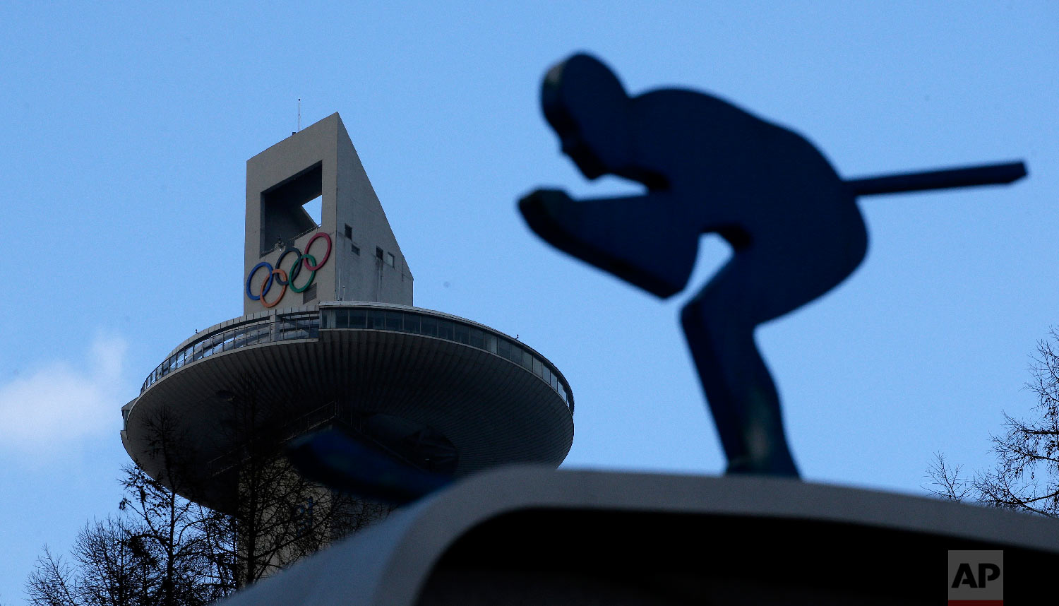 The tower of the Alpensia Ski Jumping Center rises beyond a sculpture of a skier at the 2018 Winter Olympics in Pyeongchang, South Korea, Friday, Feb. 2, 2018. (AP Photo/Charlie Riedel)