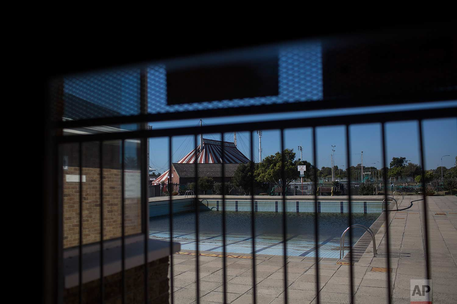 In this Thursday, Feb. 1, 2018, a public pool in Cape Town has been closed for months due to a lack of water in the city. (AP Photo/Bram Janssen)