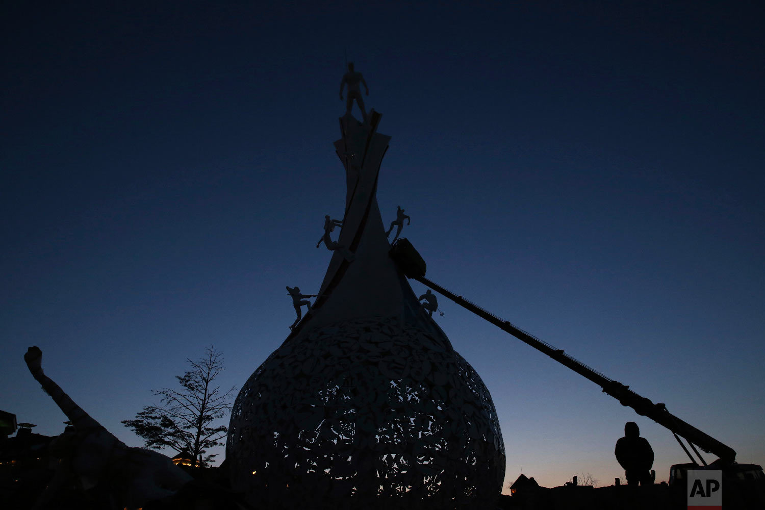 Workers continue building the Pyeongchang 2018 Symbolic Monument ahead of the 2018 Winter Olympics in Pyeongchang, South Korea, Tuesday, Feb. 6, 2018. (AP Photo/Aaron Favila)