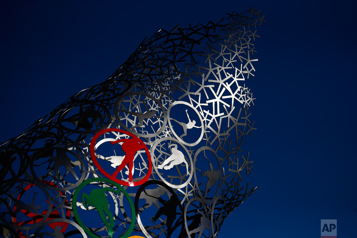 Sunlight falls on a sculpture made with rings depicting ice sports at the Olympic Park prior to the 2018 Winter Olympics in Gangneung, South Korea, Monday, Feb. 5, 2018. (AP Photo/Jae C. Hong)