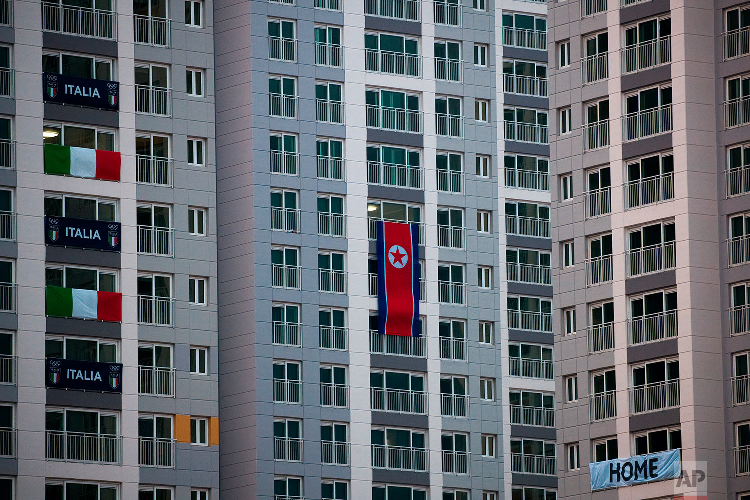 A large North Korean flag hangs from an apartment building at the Olympic Village prior to the 2018 Winter Olympics in Gangneung, South Korea, Friday, Feb. 2, 2018. (AP Photo/Jae C. Hong)