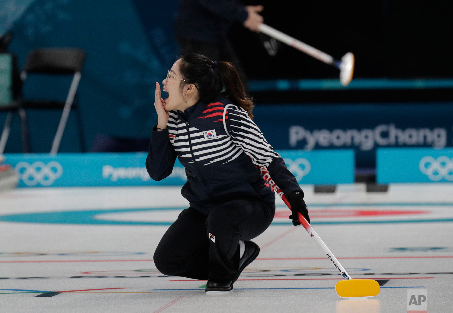 South Korea's Jang Hyeji react during the mixed doubles training session ahead of the 2018 Winter Olympics in Gangneung, South Korea, Wednesday, Feb. 7, 2018. (AP Photo/Aaron Favila)