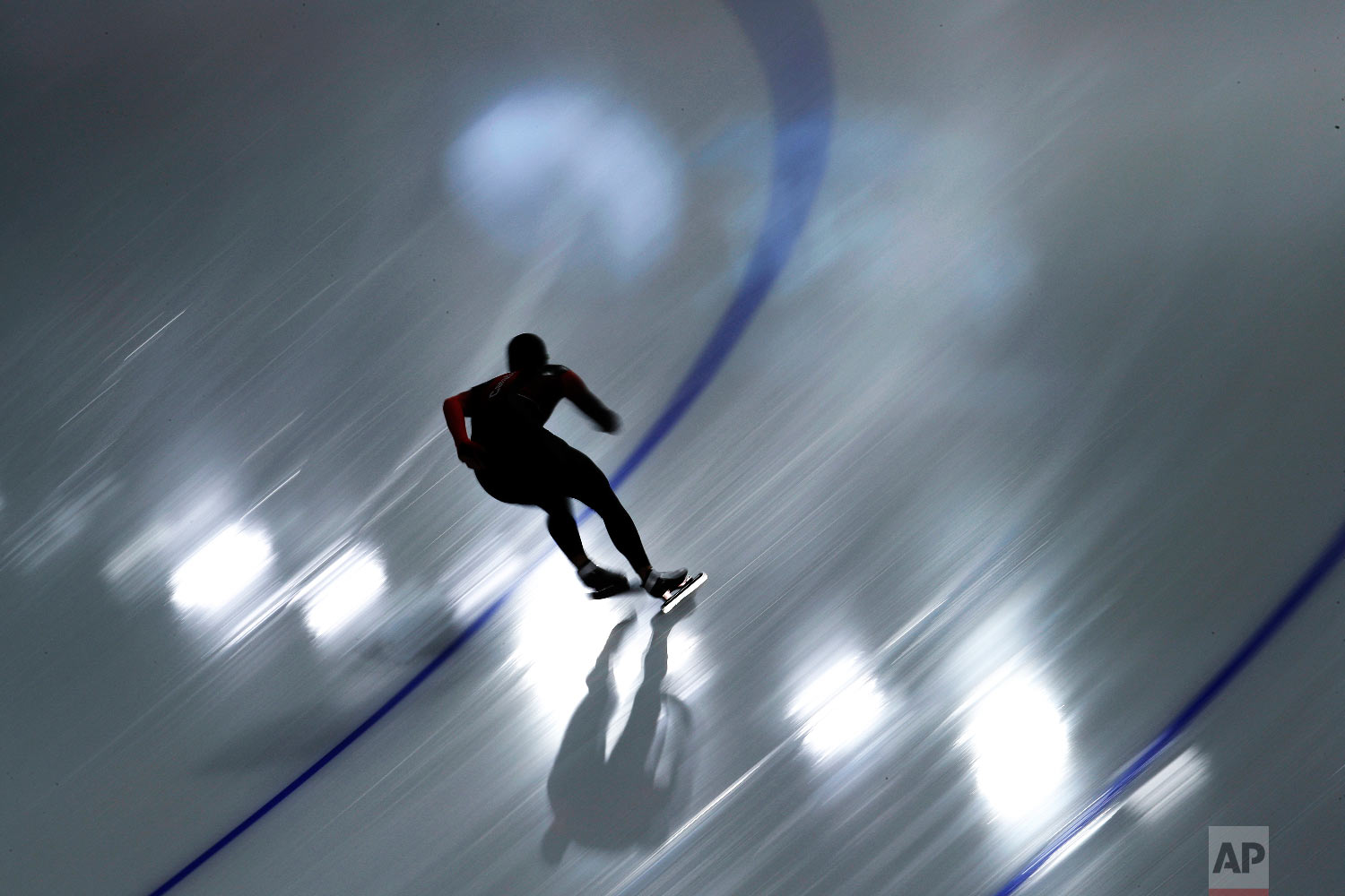 A skater practices at the Gangneung Oval during a speed skating training session prior to the 2018 Winter Olympics in Gangneung, South Korea, Thursday, Feb. 8, 2018. (AP Photo/John Locher)