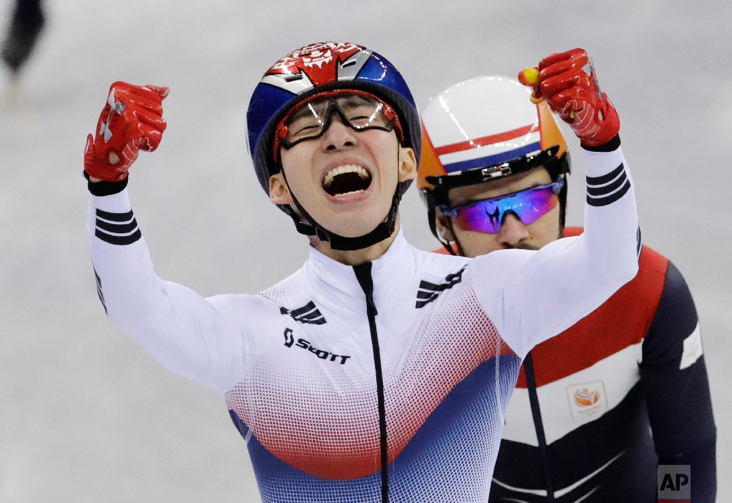 Lim Hyojun, of South Korea, celebrates after winning the men's 1500 meters short-track speedskating final in the Gangneung Ice Arena at the 2018 Winter Olympics in Gangneung, South Korea, Saturday, Feb. 10, 2018. (AP Photo/Bernat Armangue)