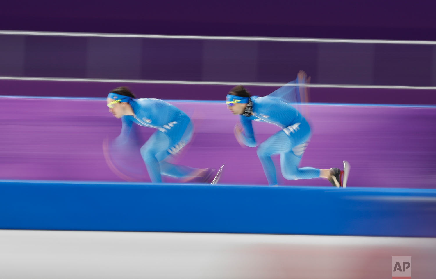 Two skaters from Italy strain during the official training session for the men's 5,000 meters race at the Gangneung Oval at the 2018 Winter Olympics in Gangneung, South Korea, Saturday, Feb. 10, 2018. (AP Photo/Petr David Josek)