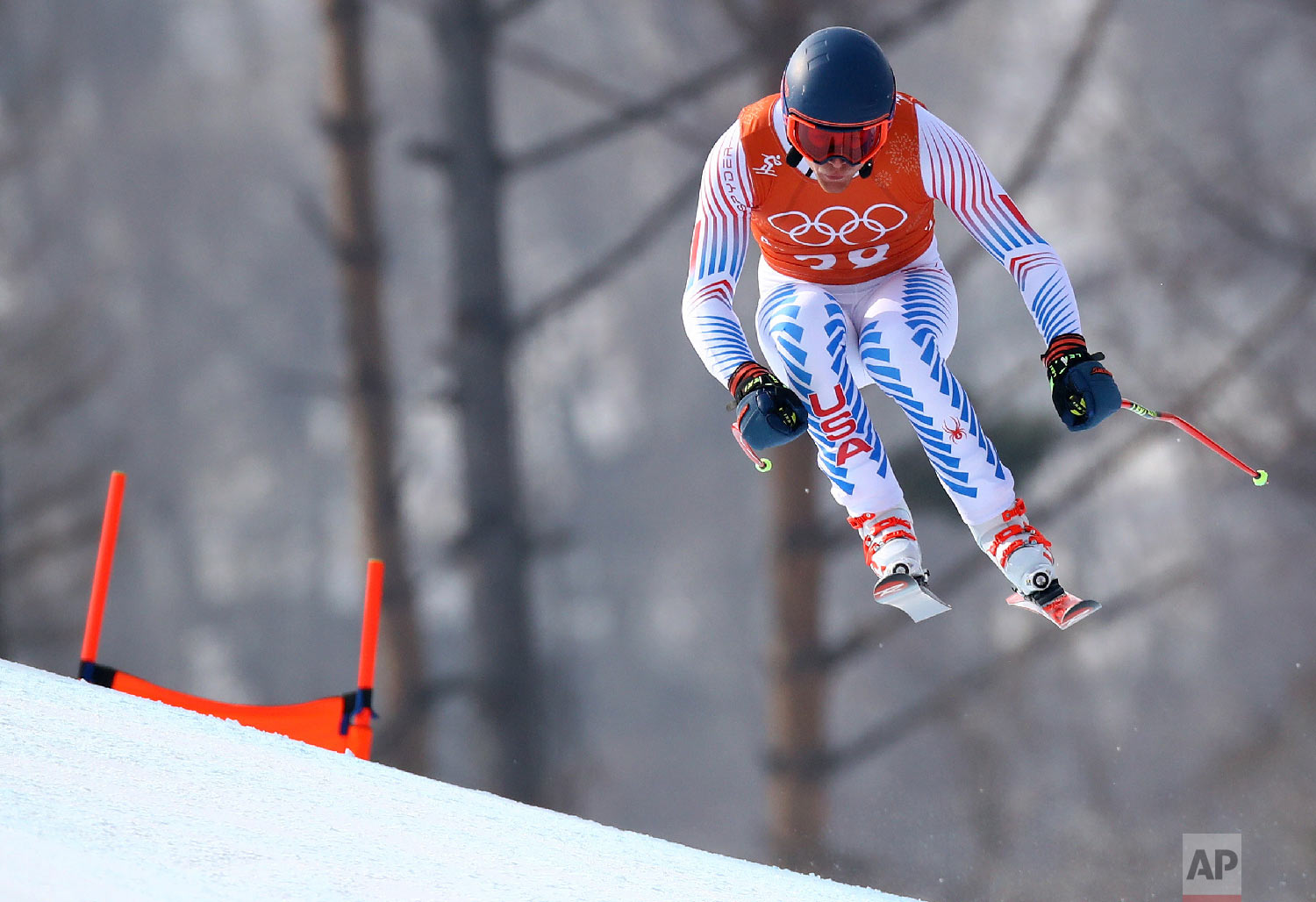 United States' Wiley Maple makes a jump during men's downhill training at the 2018 Winter Olympics in Jeongseon, South Korea, Saturday, Feb. 10, 2018. (AP Photo/Alessandro Trovati)