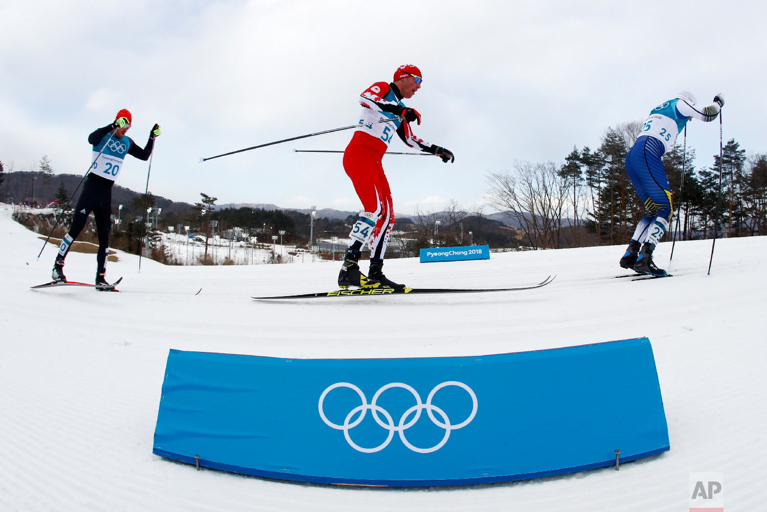 Skiers compete during the men's 15km/15km skiathlon cross-country skiing competition at the 2018 Winter Olympics in Pyeongchang, South Korea, Sunday, Feb. 11, 2018. (AP Photo/Matthias Schrader)