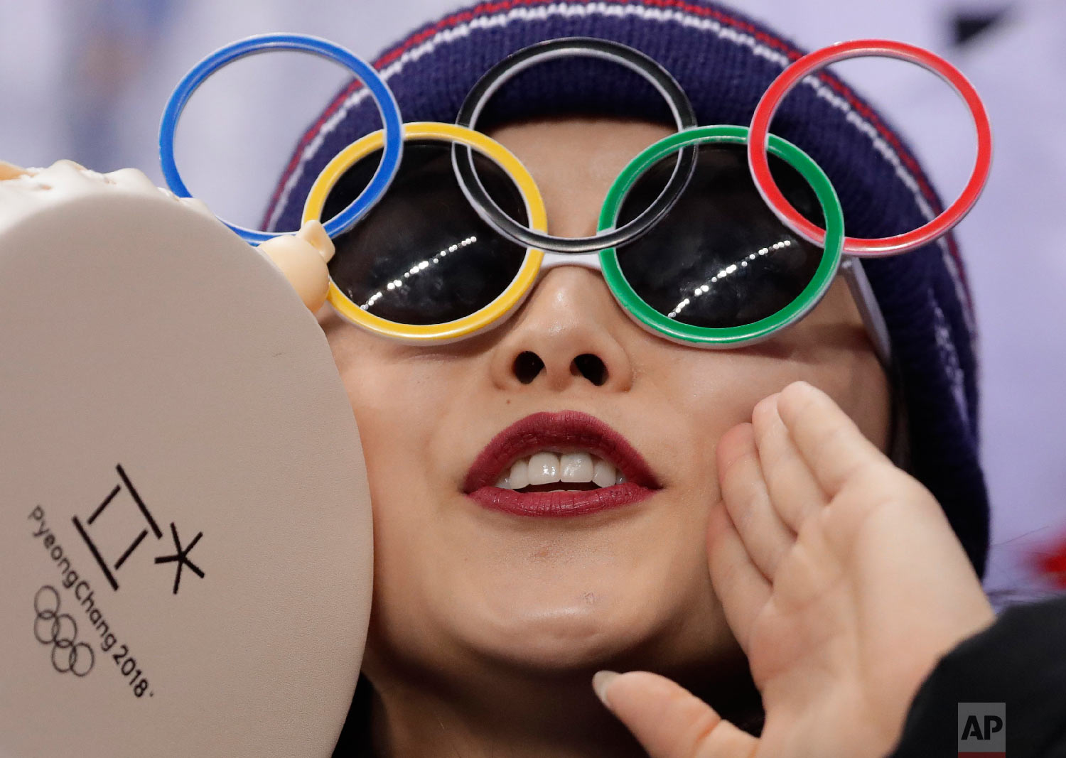 Teammate of Choi Da-bin, of South Korea, cheers her on during in the ladies single figure skating short program in the Gangneung Ice Arena at the 2018 Winter Olympics in Gangneung, South Korea, Sunday, Feb. 11, 2018. (AP Photo/Julie Jacobson)
