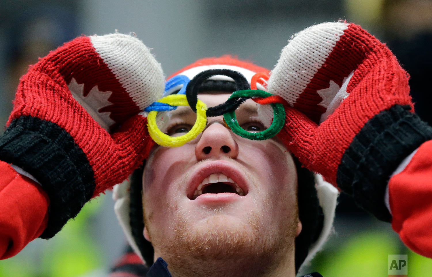 A Canadian fan watches the action during the men's luge at the 2018 Winter Olympics in Pyeongchang, South Korea, Saturday, Feb. 10, 2018. (AP Photo/Andy Wong)