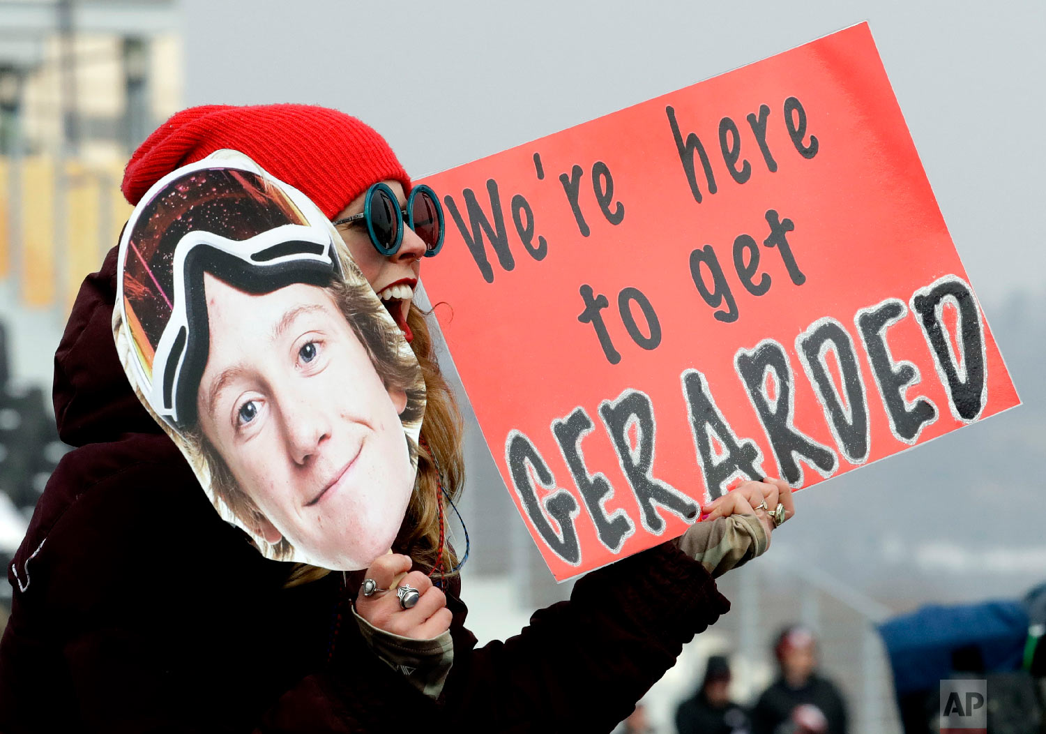 A fan cheers for RedmondGerard, of the United States, cheers during the men's slopestyle qualifying at Phoenix Snow Park at the 2018 Winter Olympics in Pyeongchang, South Korea, Saturday, Feb. 10, 2018. (AP Photo/Lee Jin-man)