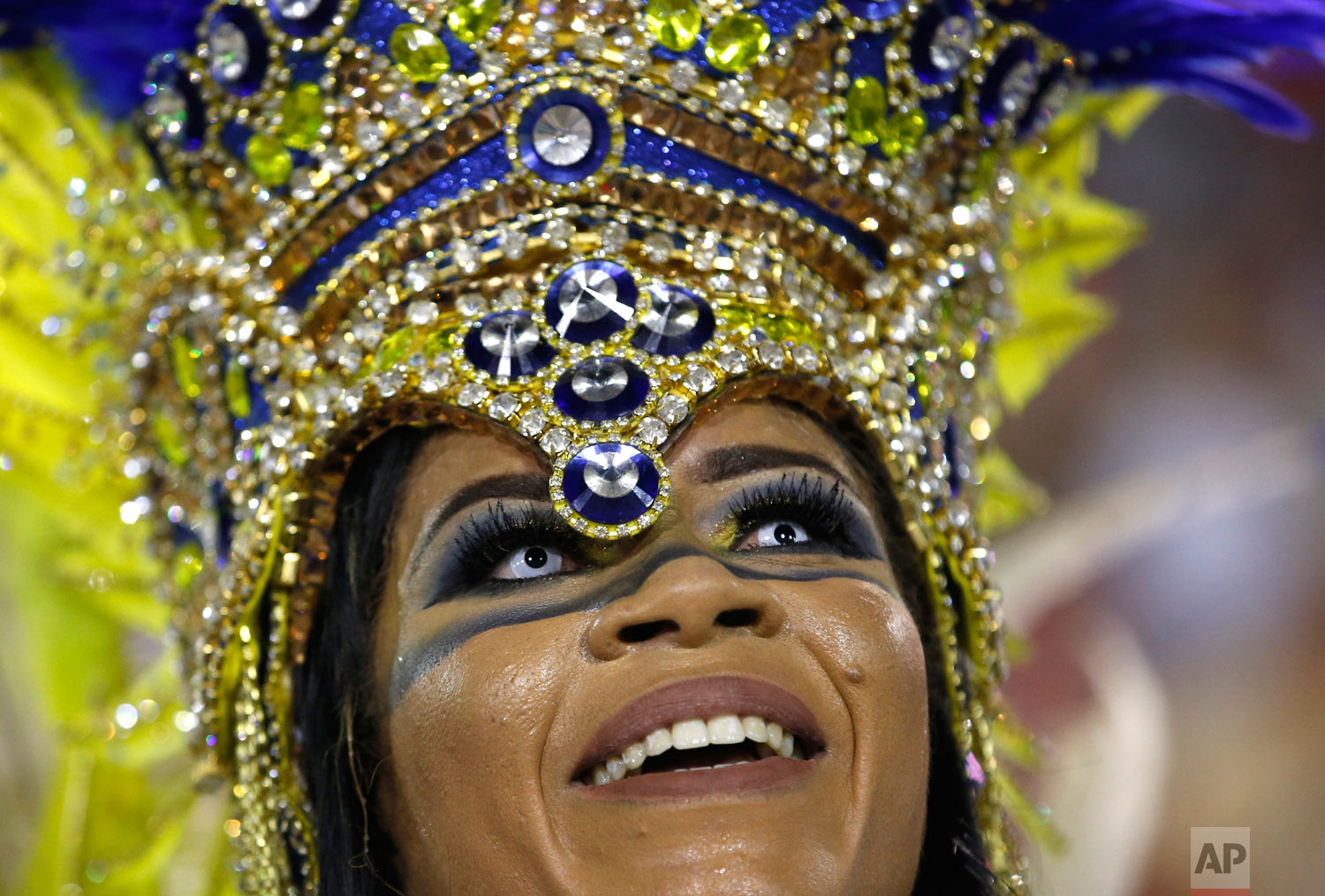 A performer from the Uniao da Ilha samba school parades during Carnival celebrations at the Sambadrome in Rio de Janeiro, Brazil, early Tuesday, Feb. 13, 2018. (AP Photo/Silvia Izquierdo)