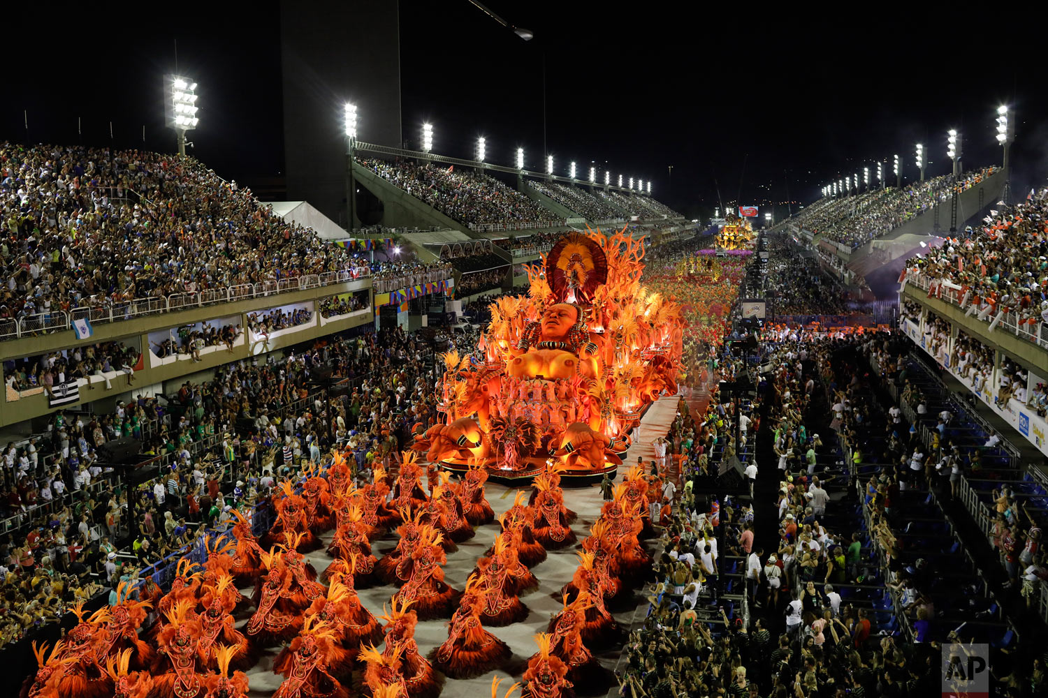 The Salgueiro samba school parades through the Sambadrome during Carnival celebrations in Rio de Janeiro, Brazil, early Tuesday, Feb. 13, 2018. (AP Photo/Leo Correa)