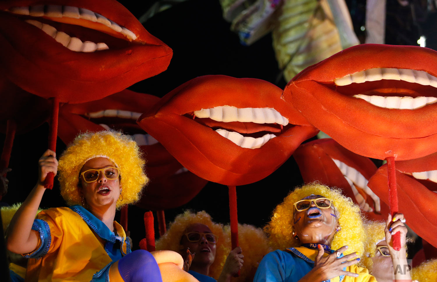 Performers from the Unidos da Tijuca samba school parade during Carnival celebrations at the Sambadrome in Rio de Janeiro, Brazil, Monday, Feb. 12, 2018. (AP Photo/Silvia Izquierdo)