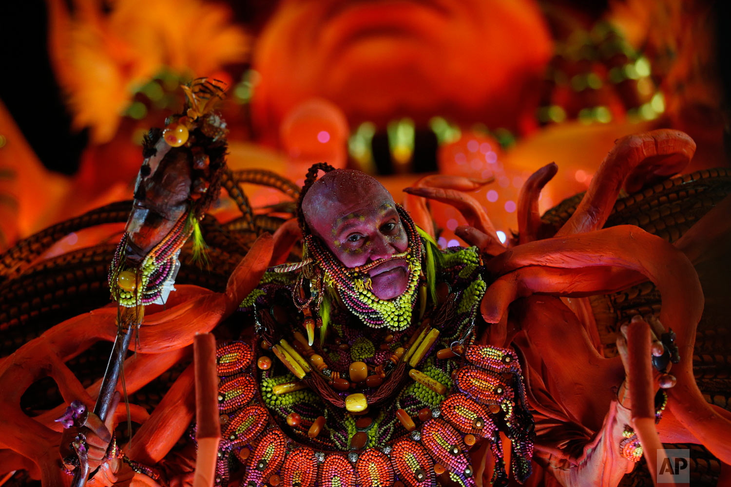 A performer from the Salgueiro samba school parades during Carnival celebrations at the Sambadrome in Rio de Janeiro, Brazil, early Tuesday, Feb. 13, 2018. (AP Photo/Silvia Izquierdo)