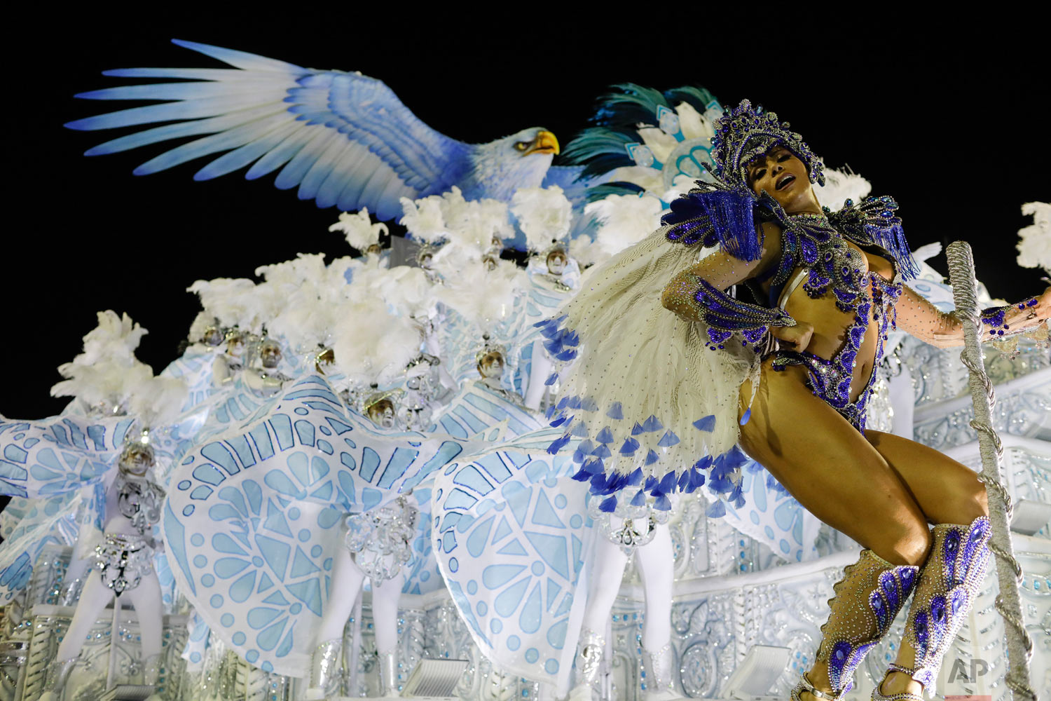 A performer from the Portela samba school parades on a float during Carnival celebrations at the Sambadrome in Rio de Janeiro, Brazil, Monday, Feb. 12, 2018. (AP Photo/Leo Correa)