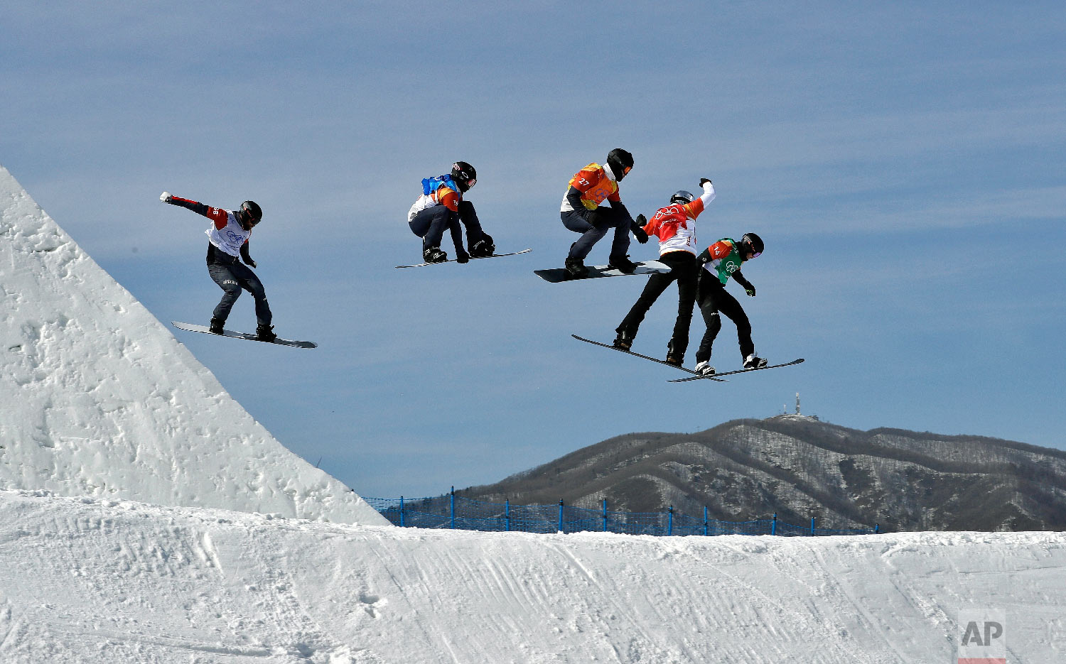 Form left; Lukas Pachner, of Austria, Jonathan Cheever, of the United States, Mick Dierdorff, of the United States, Regino Hernandez, of Spain, and Paul Berg, of Germany, run the course during the men's snowboard cross elimination round at Phoenix Snow Park at the 2018 Winter Olympics in Pyeongchang, South Korea, Thursday, Feb. 15, 2018. (AP Photo/Kin Cheung)