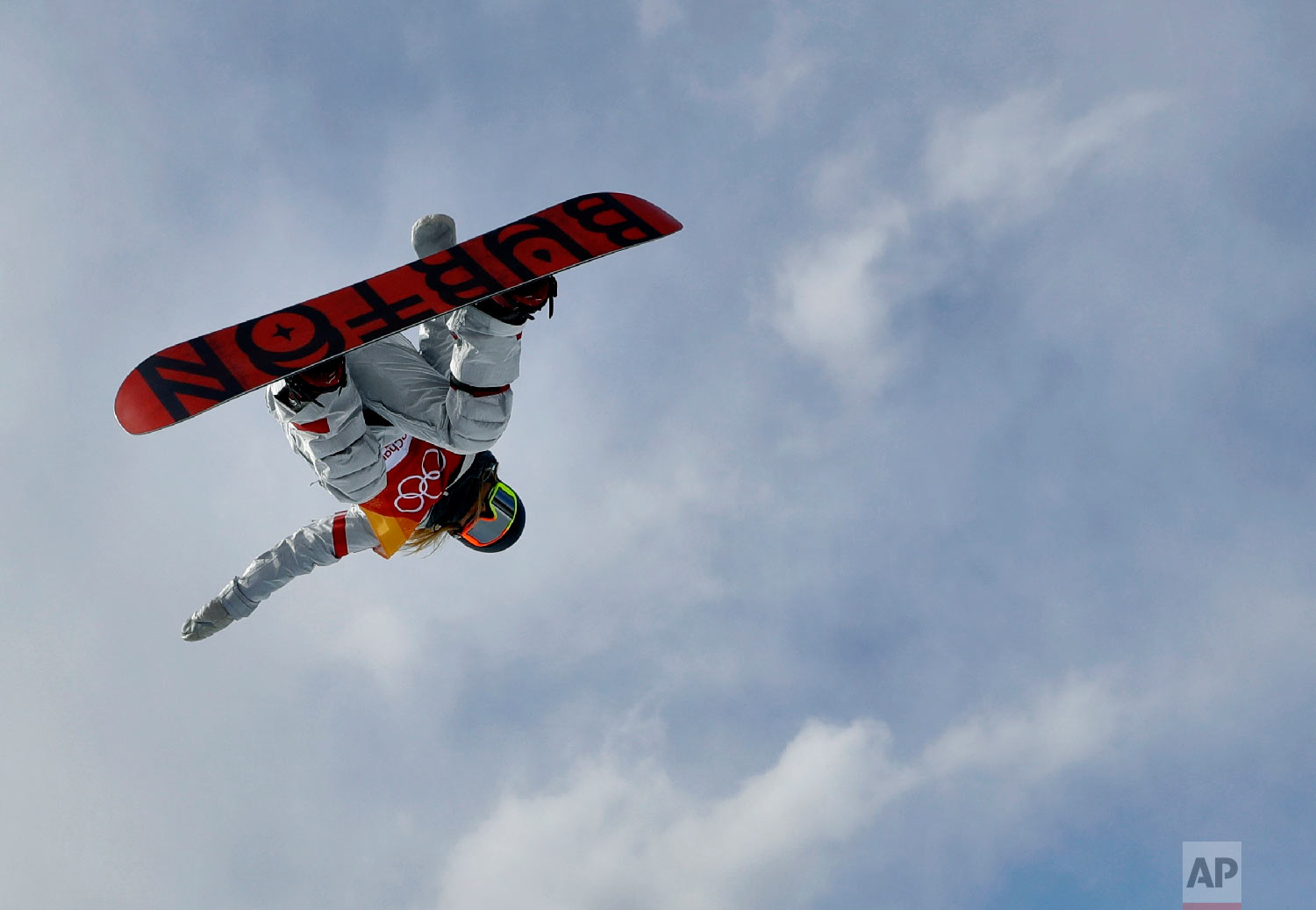 Chloe Kim, of the United States, jumps during the women's halfpipe qualifying at Phoenix Snow Park at the 2018 Winter Olympics in Pyeongchang, South Korea, Monday, Feb. 12, 2018. (AP Photo/Kin Cheung)