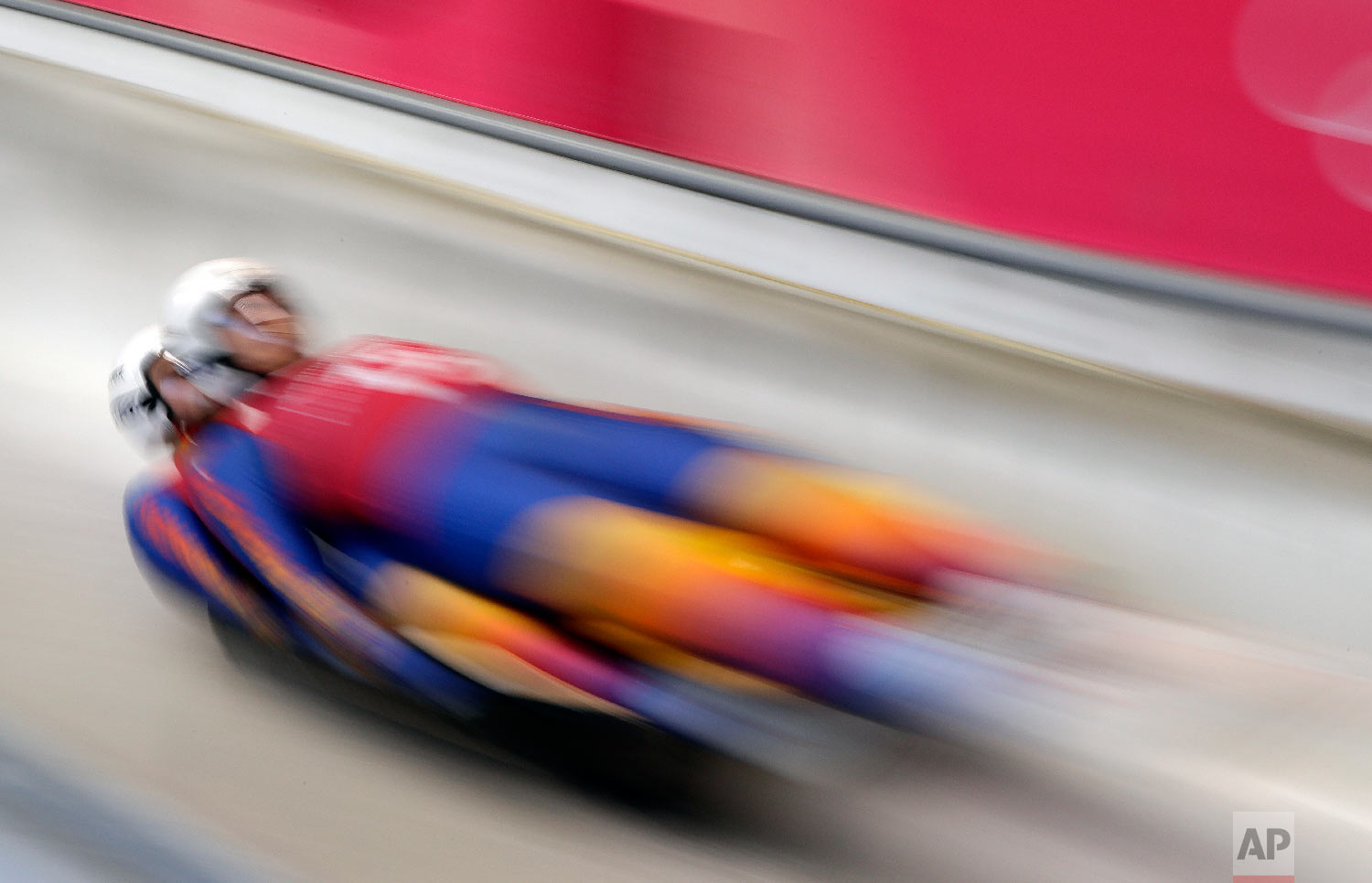 Cosmin Atodiresei and Stefan Musei of Romania start a run during the doubles luge training at the 2018 Winter Olympics in Pyeongchang, South Korea, Monday, Feb. 12, 2018. (AP Photo/Wong Maye-E)