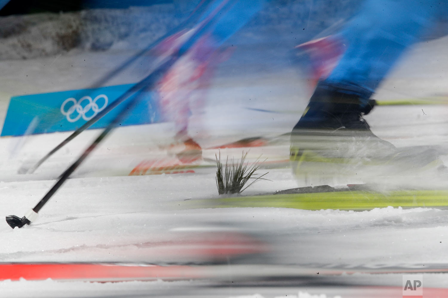 Racers compete competes during the men's cross-country skiing sprint classic at the 2018 Winter Olympics in Pyeongchang, South Korea, Tuesday, Feb. 13, 2018. (AP Photo/Dmitri Lovetsky)