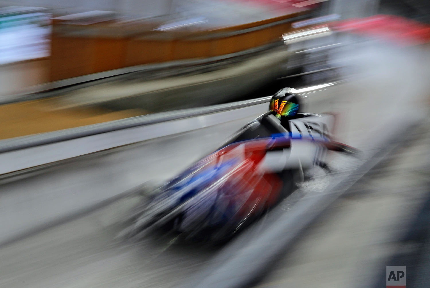 Driver Codie Bascue and Samuel McGuffie of the United States take a practice run during training for the two-man bobsled at the 2018 Winter Olympics in Pyeongchang, South Korea, Thursday, Feb. 15, 2018. (AP Photo/Wong Maye-E)