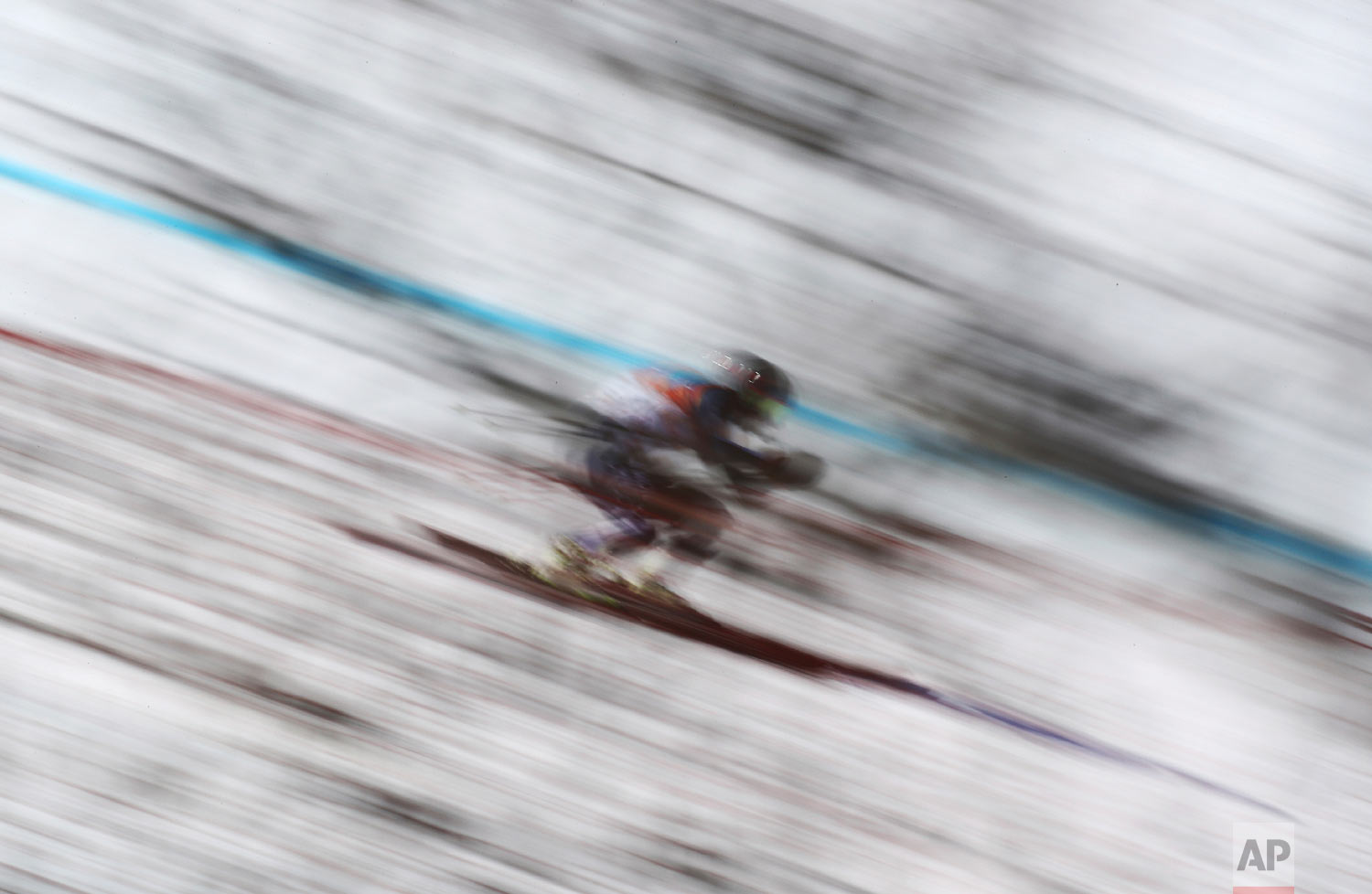 Monaco's Olivier Jenot skis during the downhill portion of the men's combined at the 2018 Winter Olympics in Jeongseon, South Korea, Tuesday, Feb. 13, 2018. (AP Photo/Alessandro Trovati)