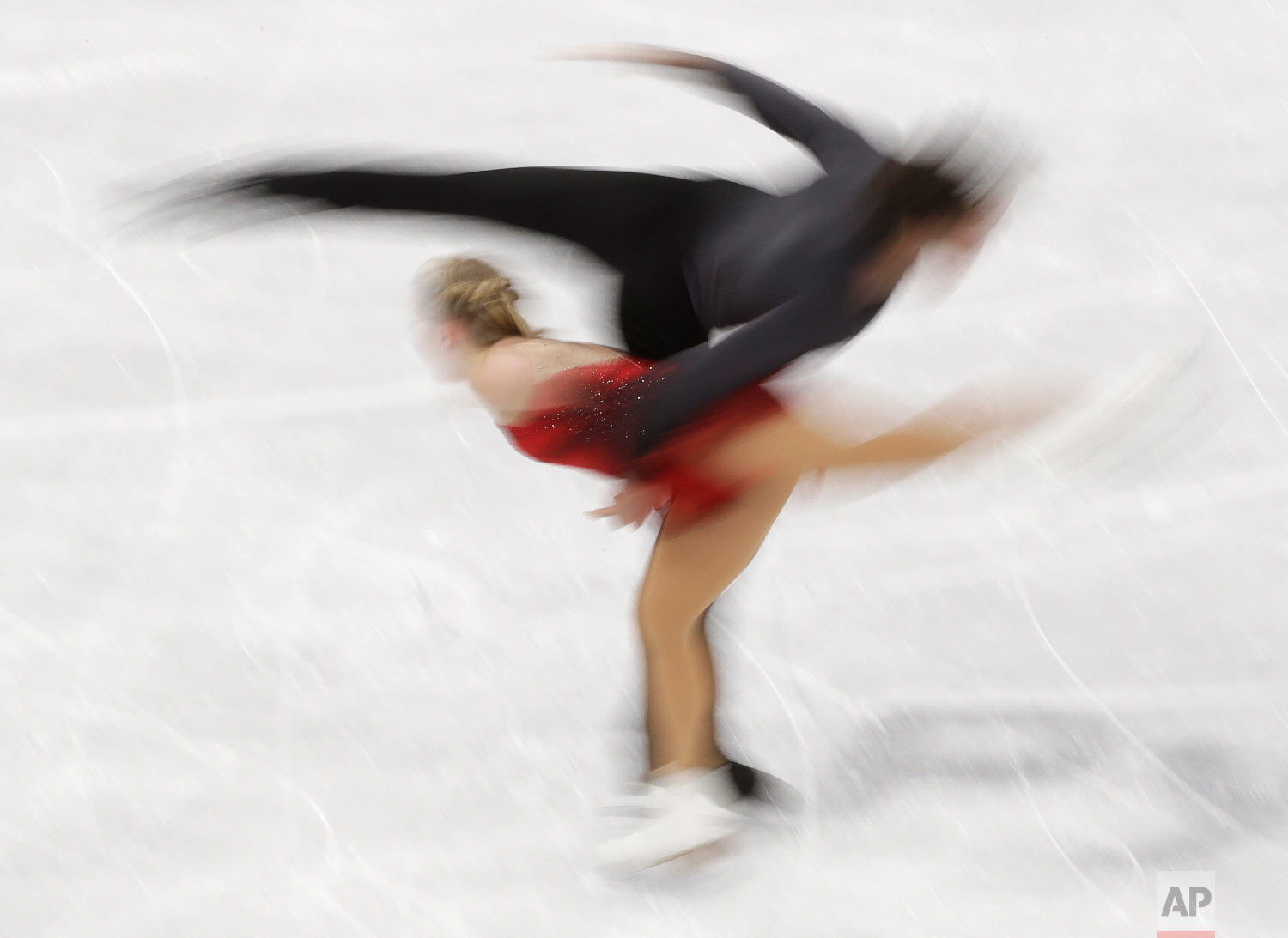 Julianne Seguin and Charlie Bilodeau, of Canada, perform in the pairs free skate figure skating final in the Gangneung Ice Arena at the 2018 Winter Olympics in Gangneung, South Korea, Thursday, Feb. 15, 2018. (AP Photo/David J. Phillip)