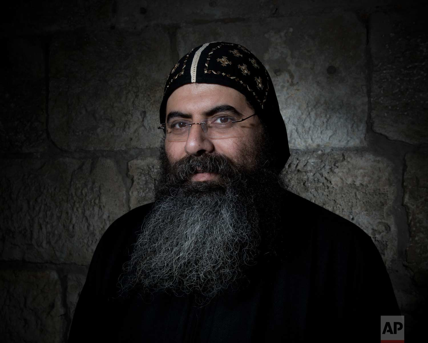 In this Sunday, Feb. 11, 2018 photo, Antonius Orshalimy, Secretary of the Coptic Orthodox Church in Jerusalem poses for a portrait in Jerusalem's Old City. (AP Photo/Oded Balilty)