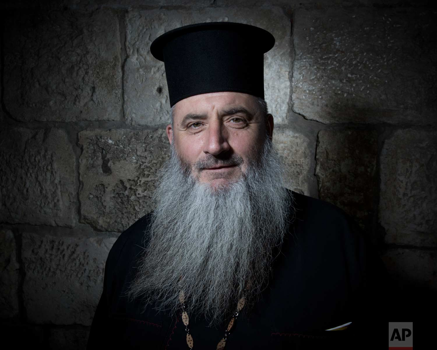 In this Sunday, Feb. 11, 2018 photo, Father Boris Manov poses for a portrait in Jerusalem's Old City. (AP Photo/Oded Balilty)