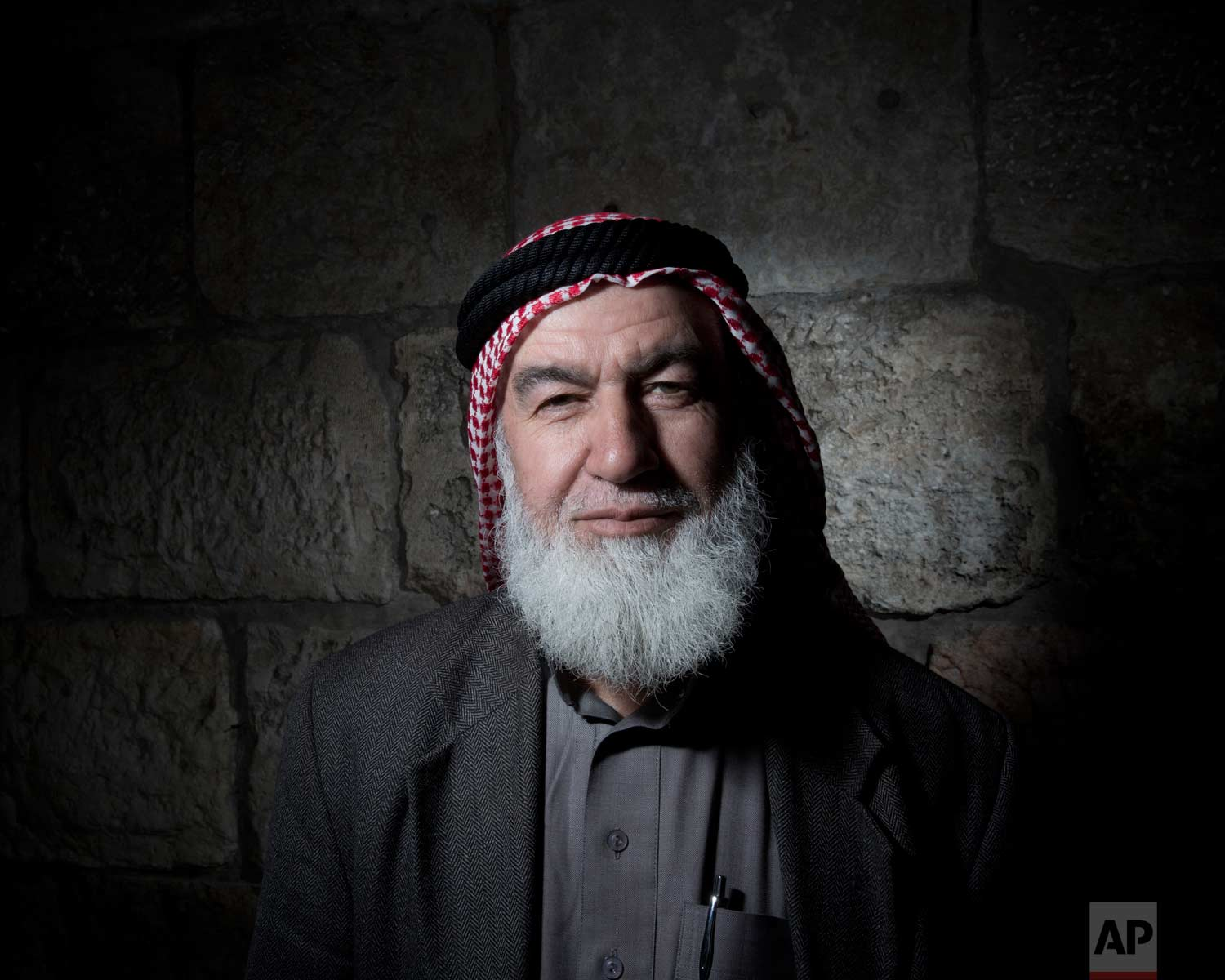 In this Sunday, Feb. 11, 2018 photo, Ebrahim Hamada poses for a portrait in Jerusalem's Old City. (AP Photo/Oded Balilty)