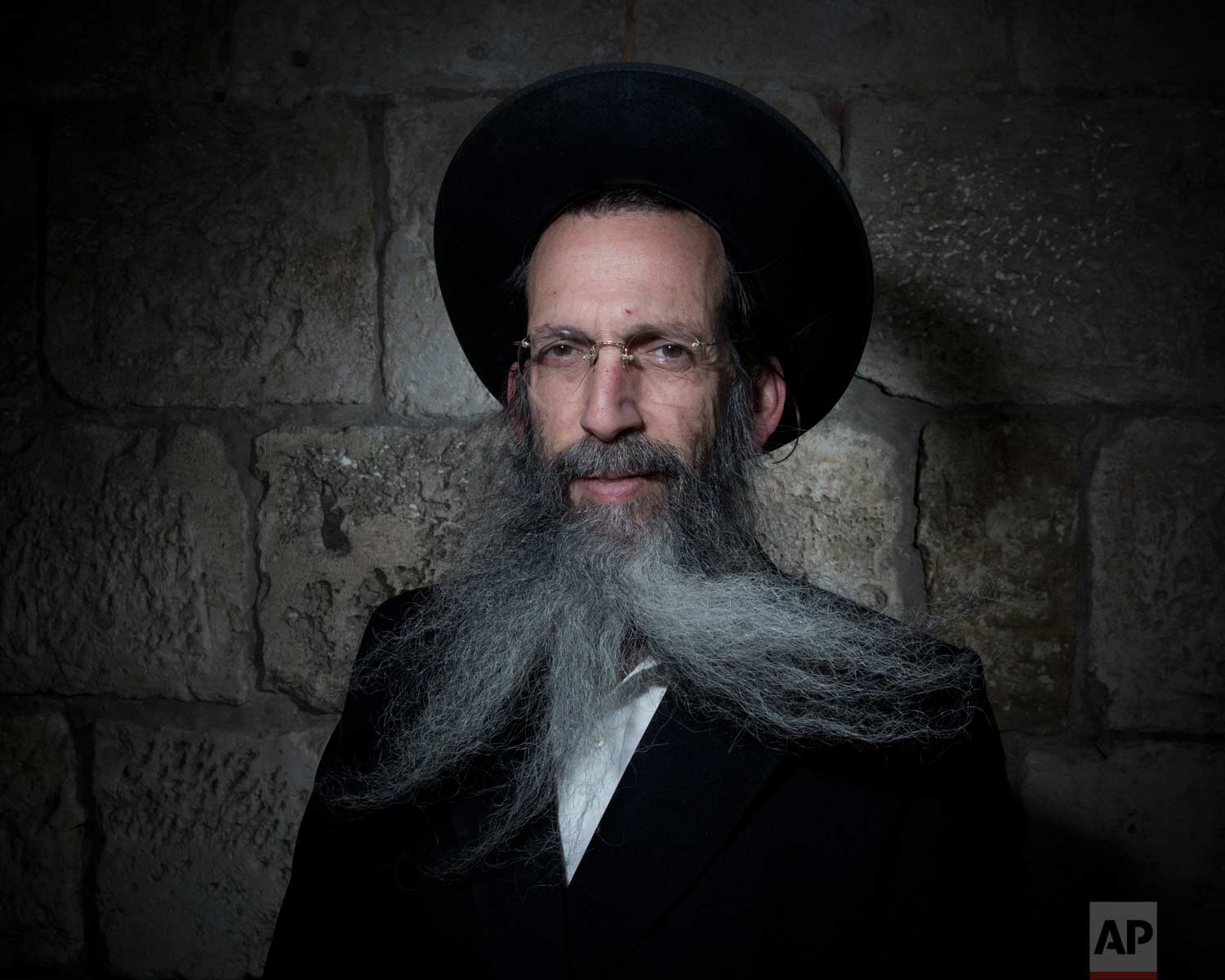 In this Sunday, Feb. 11, 2018 photo, Tzvi Schiff, a, Ultra-Orthodox Jew, poses for a portrait in Jerusalem's Old City. (AP Photo/Oded Balilty)