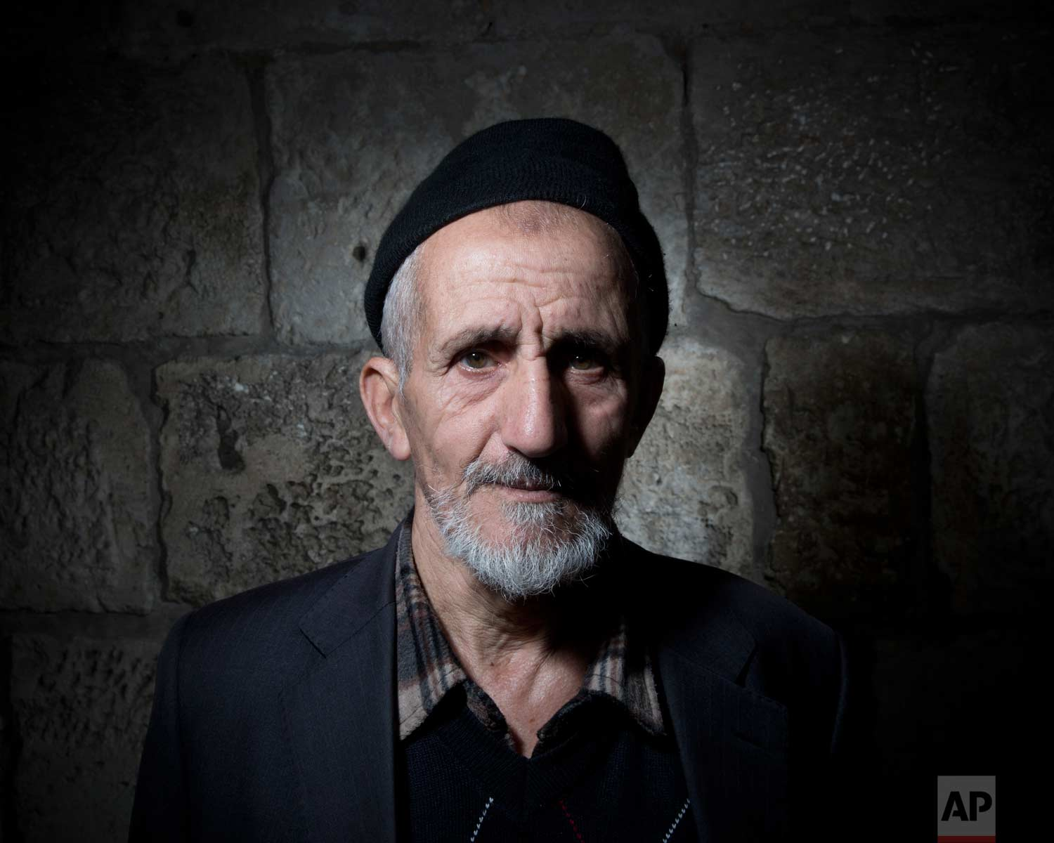 In this Sunday, Feb. 11, 2018 photo, Palestinian Mohammed Asmai poses for a portrait in Jerusalem's Old City. (AP Photo/Oded Balilty)