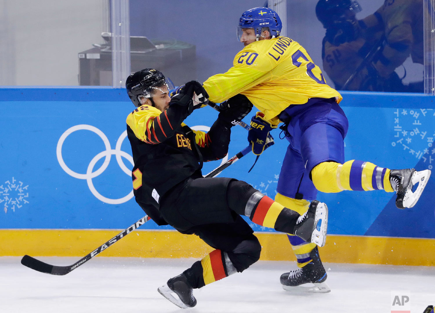 Joel Lundqvist (20), of Sweden, and Yasin Ehliz (42), of Germany, collide during the third period of a preliminary round men's hockey game at the 2018 Winter Olympics, Friday, Feb. 16, 2018, in Gangneung, South Korea. Sweden won 1-0. (AP Photo/Matt Slocum)