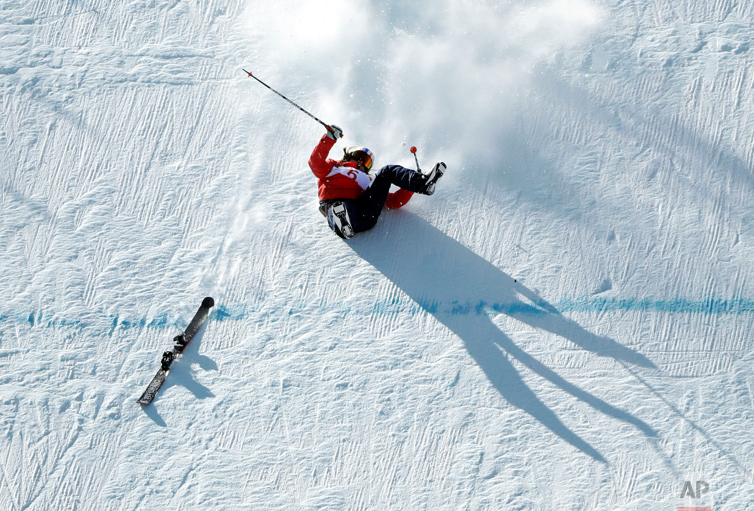 TessLedeux, of France, crashes during the women's slopestyle qualifying at Phoenix Snow Park at the 2018 Winter Olympics in Pyeongchang, South Korea, Saturday, Feb. 17, 2018. (AP Photo/Gregory Bull)