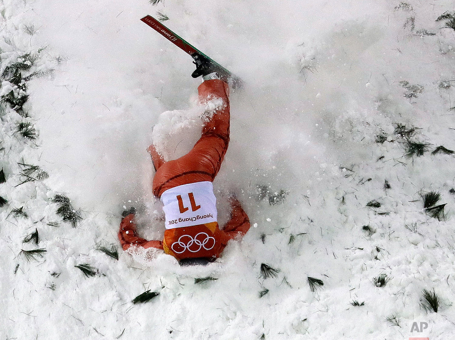 AllaTsuper, of Belarus, crashes during the women's freestyle aerial final at Phoenix Snow Park at the 2018 Winter Olympics in Pyeongchang, South Korea, Friday, Feb. 16, 2018. (AP Photo/Lee Jin-man)