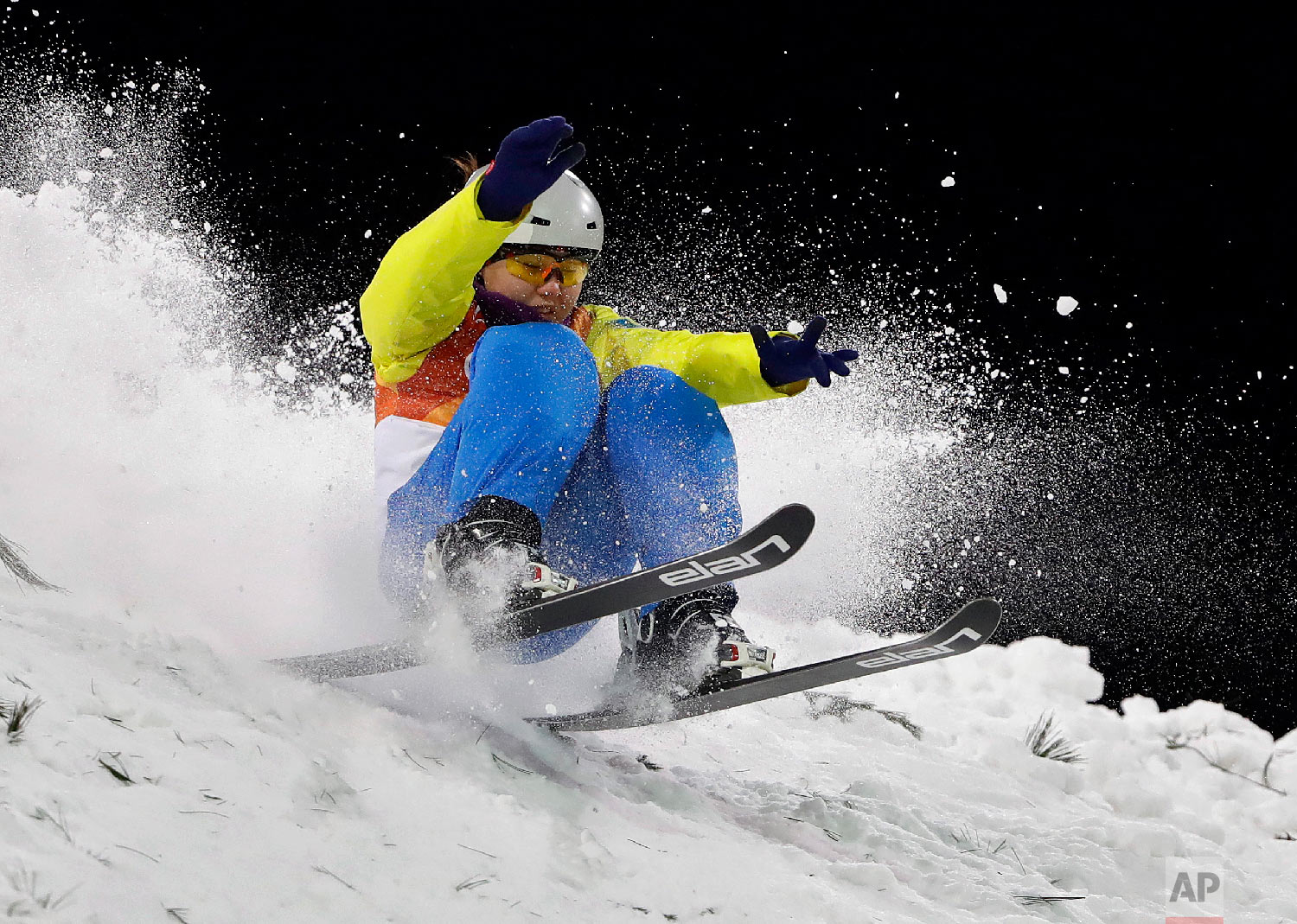 AyanaZholdas, of Kazakhstan, crashes during the women's aerials qualifying at Phoenix Snow Park at the 2018 Winter Olympics in Pyeongchang, South Korea, Thursday, Feb. 15, 2018. (AP Photo/Gregory Bull)