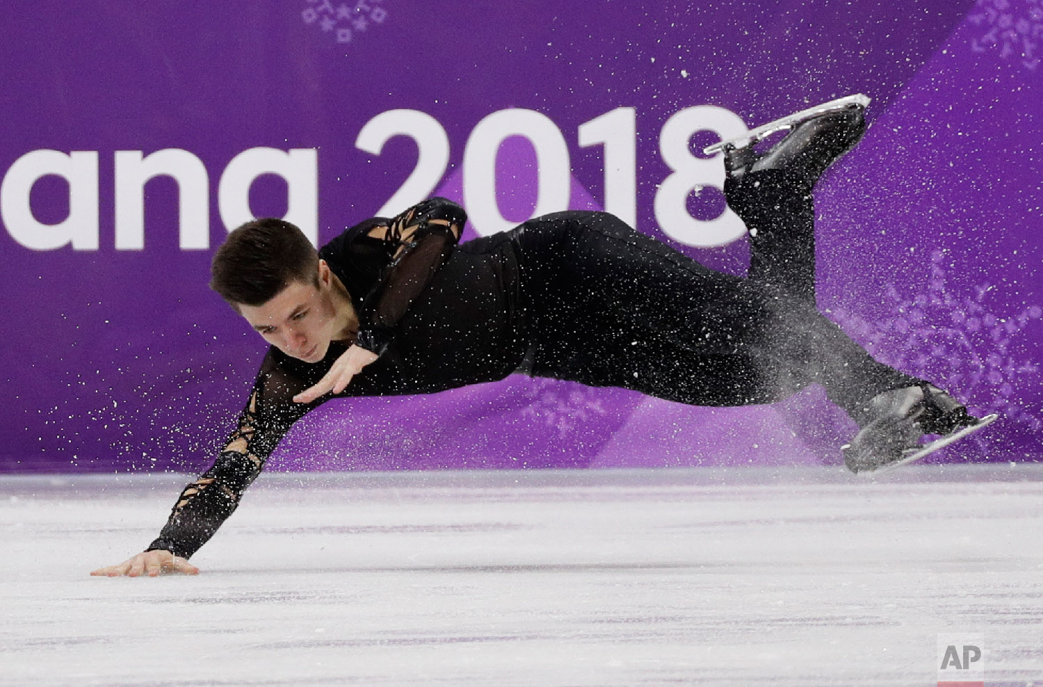 Yaroslav Paniot of Ukraine falls while performing in the men's short program figure skating in the Gangneung Ice Arena at the 2018 Winter Olympics in Gangneung, South Korea, Friday, Feb. 16, 2018. (AP Photo/David J. Phillip)