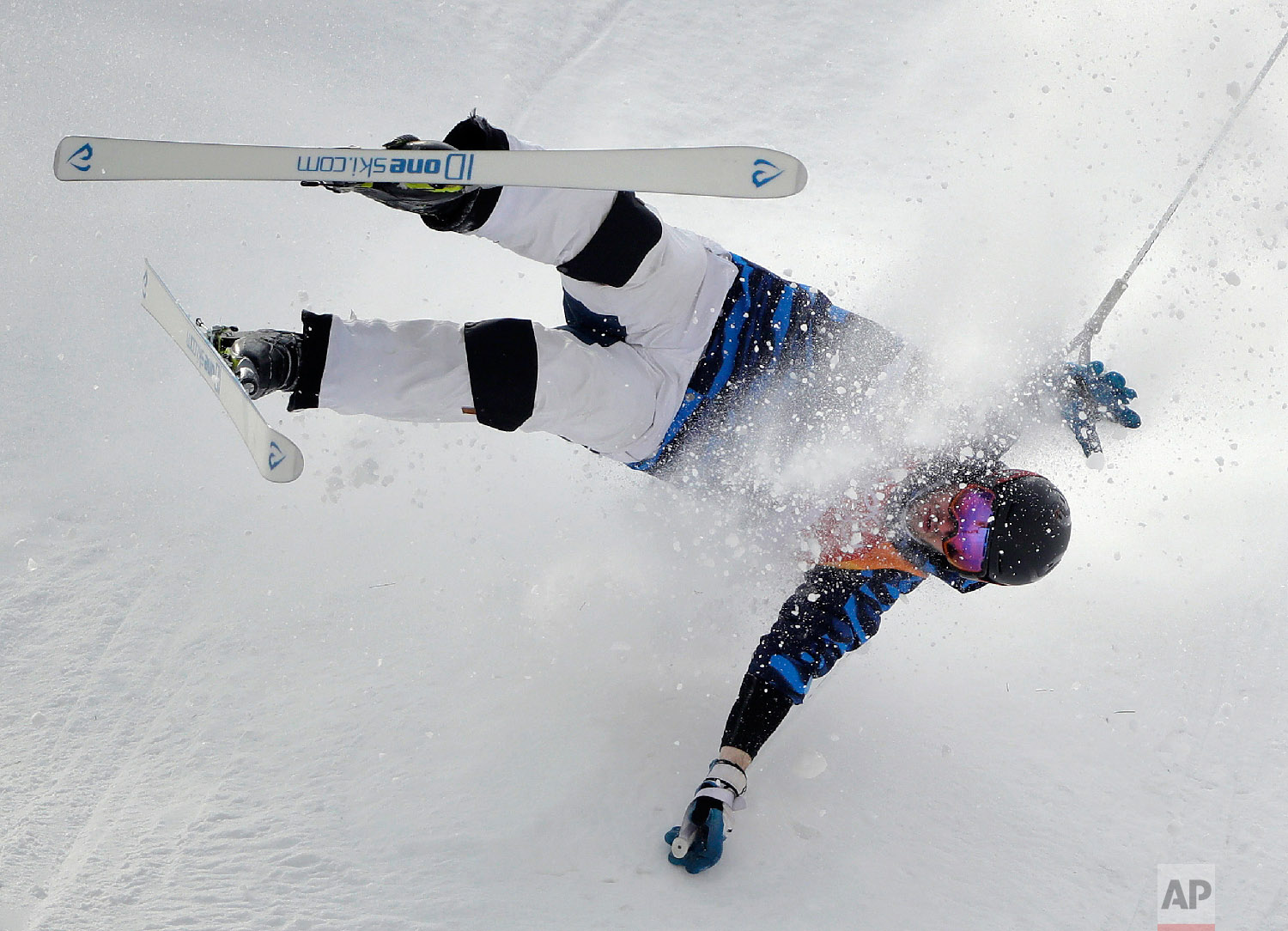 Jussi Penttala, of Finland, crashes during the men's moguls qualifying at Phoenix Snow Park at the 2018 Winter Olympics in Pyeongchang, South Korea, Friday, Feb. 9, 2018. (AP Photo/Gregory Bull)