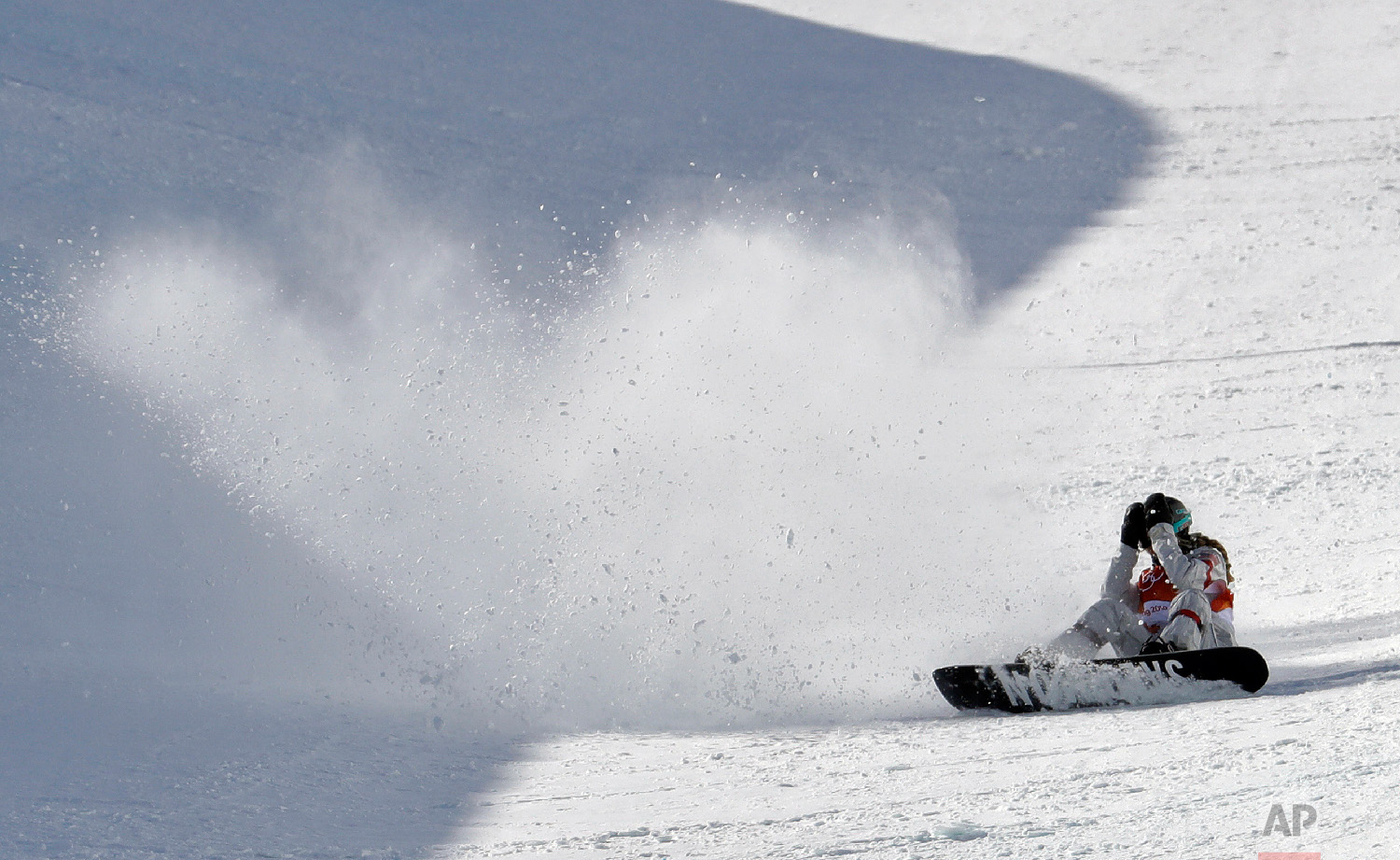 MaddieMastro, of the United States, reacts after crashing during the women's halfpipe finals at Phoenix Snow Park at the 2018 Winter Olympics in Pyeongchang, South Korea, Tuesday, Feb. 13, 2018. (AP Photo/Lee Jin-man)