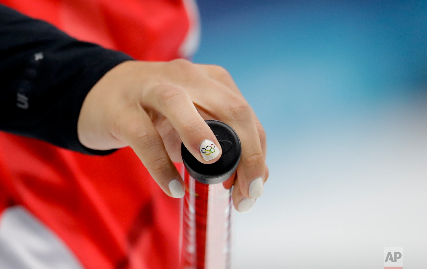 Canada's skip Rachel Homan holds her broom during a women's curling match against Denmark at the 2018 Winter Olympics in Gangneung, South Korea, Friday, Feb. 16, 2018. (AP Photo/Natacha Pisarenko)