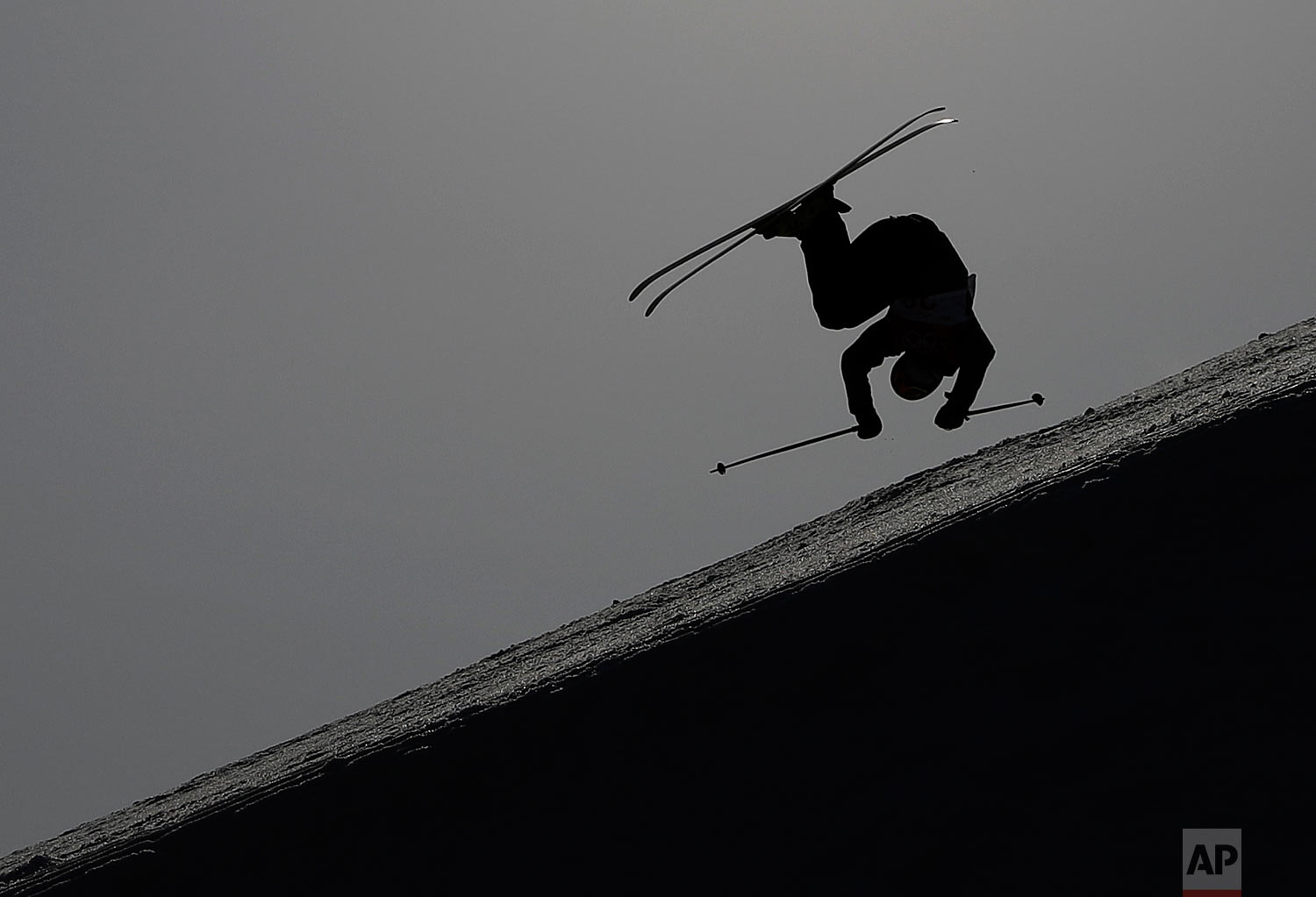 Christian Nummedal, of Norway, jumps during the men's slopestyle qualifying at Phoenix Snow Park at the 2018 Winter Olympics in Pyeongchang, South Korea, Sunday, Feb. 18, 2018. (AP Photo/Kin Cheung)