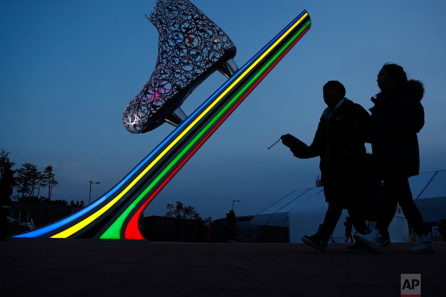 Spectators arrive for the women's 1,000 meters speedskating race at the Gangneung Oval at the 2018 Winter Olympics in Gangneung, South Korea, Wednesday, Feb. 14, 2018. (AP Photo/John Locher)