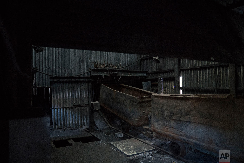 Old mine carts sit inside an abandoned coal mine in the town of Sabuk, Jeongseon county, South Korea, Thursday, Feb. 15, 2018. (AP Photo/Felipe Dana)