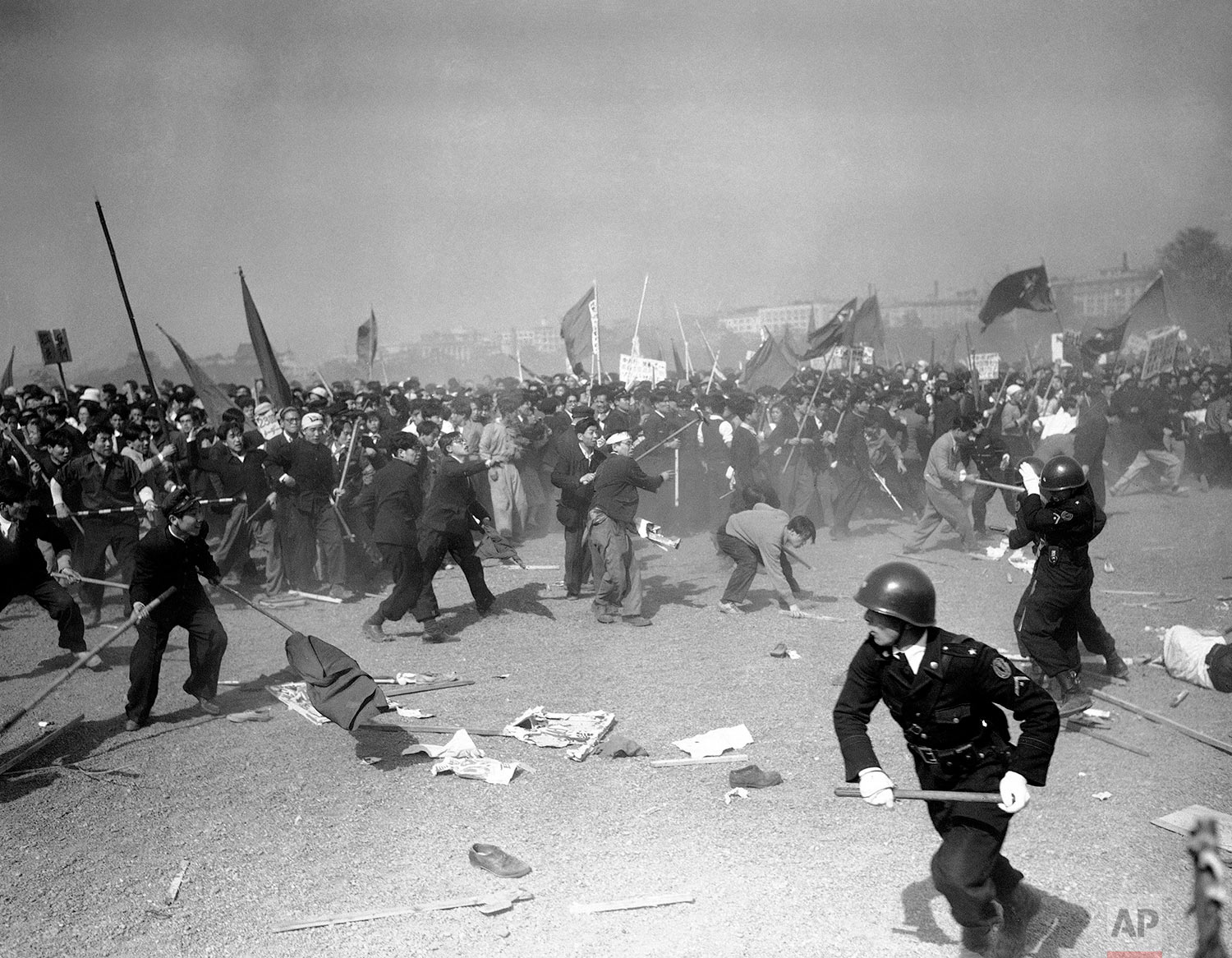Demonstrators stone Japanese policemen at the height of the pro-Red May Day riots in downtown Tokyo on May 1, 1952. (AP Photo/Max Desfor)