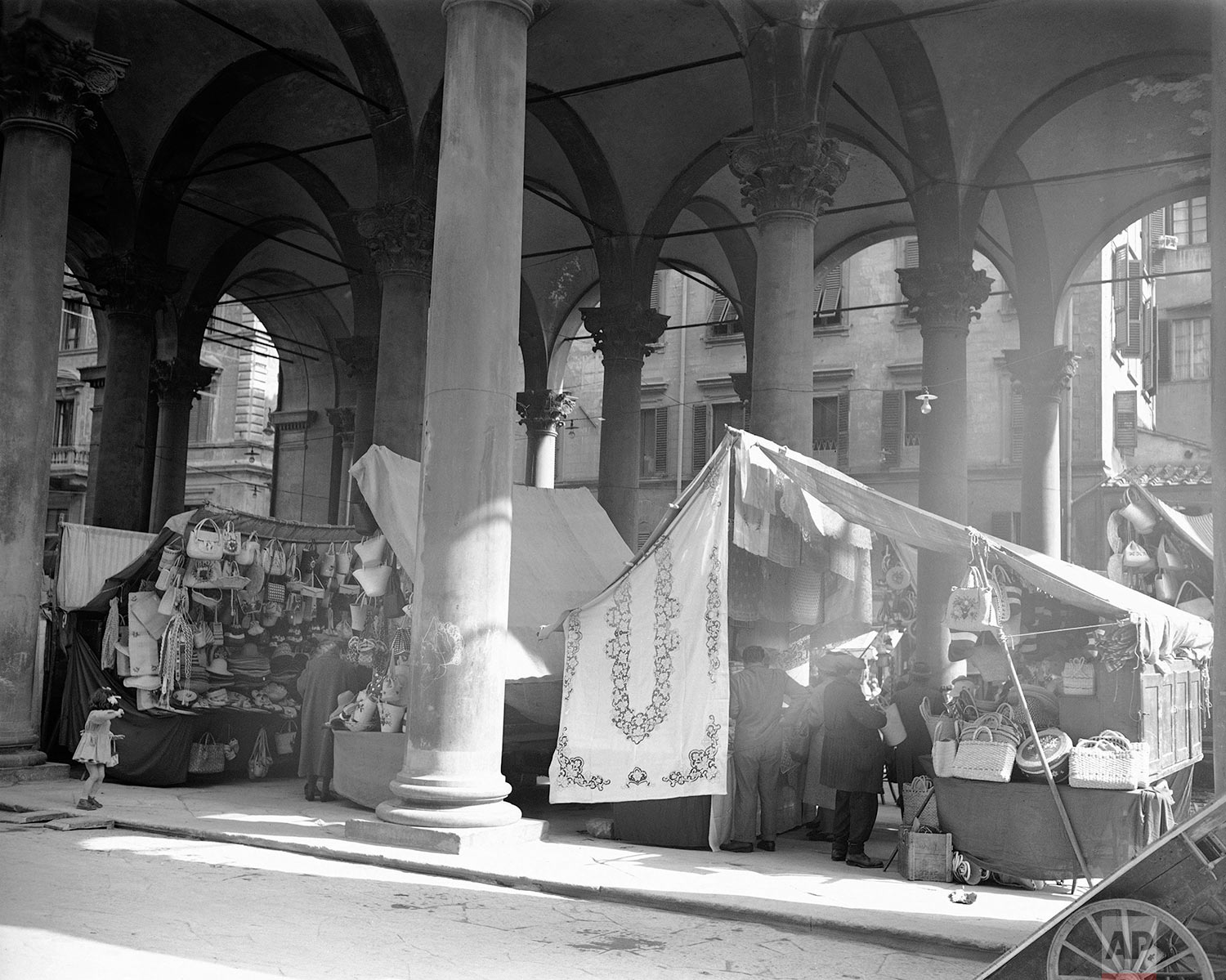 Scene in the new market in Florence, March 16, 1950 where all Florentine products are available. On display are the famous straw-women baskets and hats and liner cloth. (AP Photo/Max Desfor)