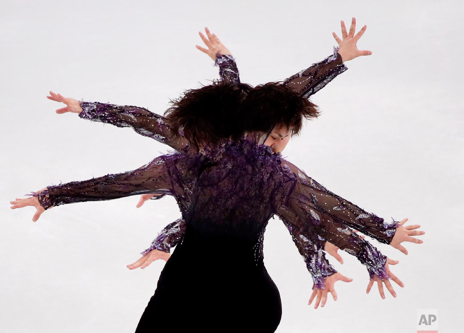 In this multiple exposed image Japan's Shoma Uno performs in the men's single short program team event at the 2018 Winter Olympics in Gangneung, South Korea, Friday, Feb. 9, 2018. (AP Photo/Julie Jacobson)