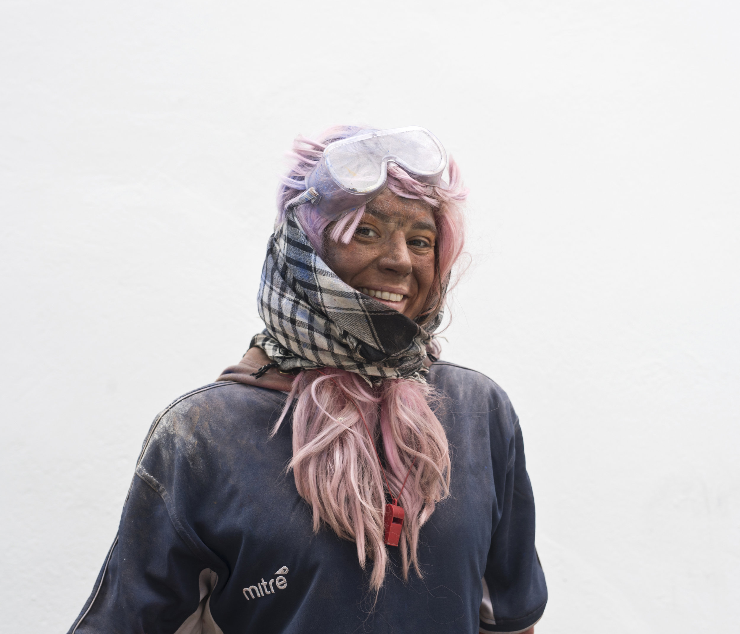 In this Monday, Feb. 19, 2018 photo Konstantina Karibouza 30, poses for a portrait as she takes part in the flour war, a unique colorful flour fight marking the end of the carnival season in the port town of Galaxidi, some 200 kilometers (120 miles) west of Athens. (AP Photo/Petros Giannakouris)