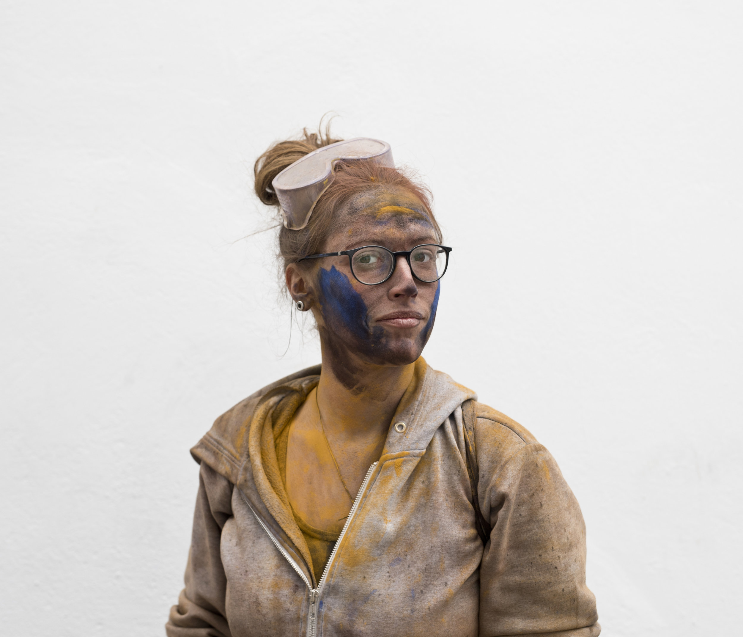 In this Monday, Feb. 19, 2018 photo Claire 24, from France, poses for a portrait as she takes part in the flour war, a unique colorful flour fight marking the end of the carnival season in the port town of Galaxidi, some 200 kilometers (120 miles) west of Athens. (AP Photo/Petros Giannakouris)