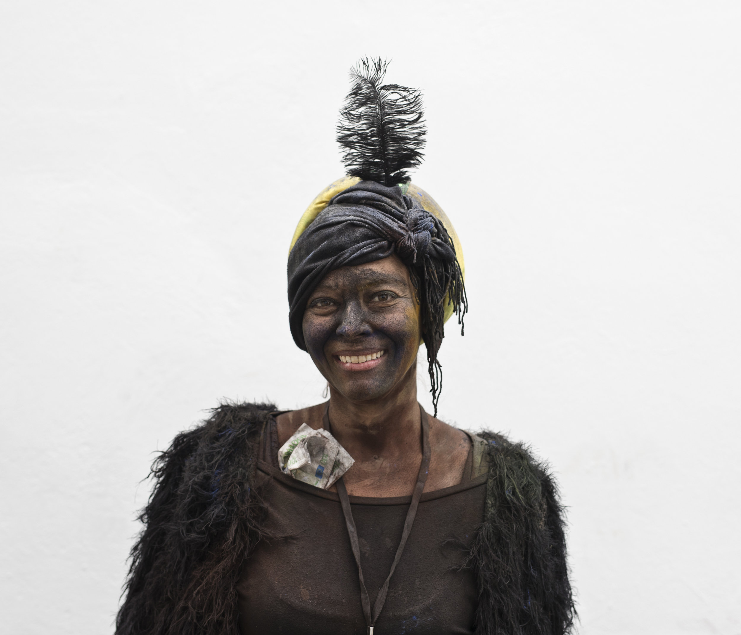 In this Monday, Feb. 19, 2018 photo Viki, first name given, poses for a portrait as she takes part in the flour war, a unique colorful flour fight marking the end of the carnival season in the port town of Galaxidi, some 200 kilometers (120 miles) west of Athens. (AP Photo/Petros Giannakouris)