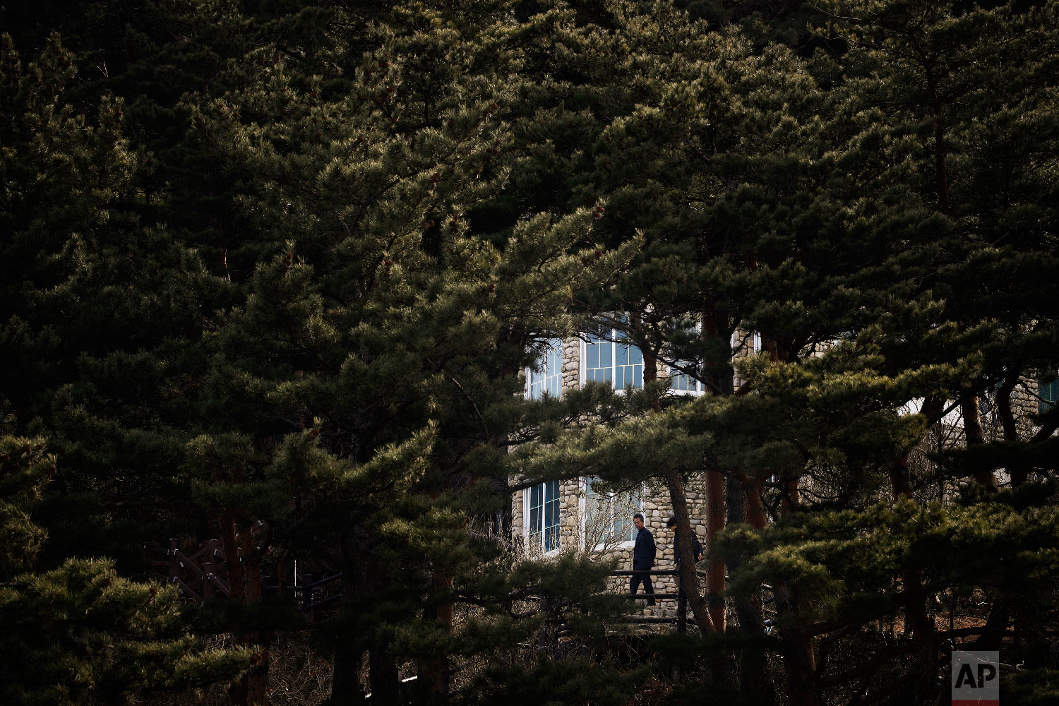 Surrounded by pine trees, visitors tour the villa known as Hwajinpo Castle, once a holiday home for late North Korea founder Kim Il Sung, at Hwajinpo Beach, South Korea, Monday, Feb. 19, 2018.(AP Photo/Jae C. Hong)